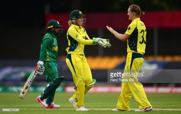Alyssa Healy and Sarah Aley of Australia celebrate the wicket of Waheeda Akhter of Pakistan during the ICC Women's World Cup Warm Up Match between...