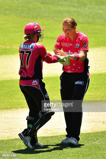 Alyssa Healy and Sarah Aley of the Sixers celebrate after taking a wicket during the WBBL match between the Strikers and Sixers at the Adelaide Oval...