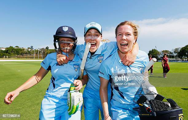 Alyssa Healy Ellyse Perry and Alex Blackwell celebrate during the WNCL Final match betwee Queensland and New South Wales at Allan Border Field on...