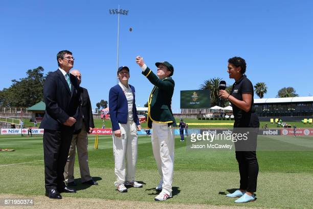 Alyssa Healy of Australia and Heather Knight of England take part in the coin toss prior to the Women's Test match between Australia and England at...