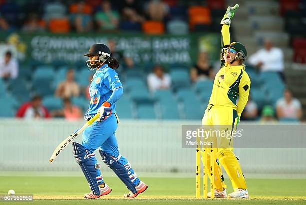 Alyssa Healy of Australia appeals for LBW during game one of the Women's ODI series between Australia and India at Manuka Oval on February 2 2016 in...