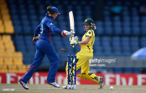 Alyssa Healy of Australia is bowled by Danielle Hazell of England during the ICC Women's World Twenty20 2012 Final between Australia and England at R...