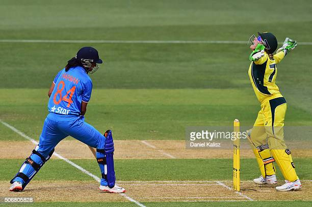 Alyssa Healy of Australia reacts after taking a catch to dismiss Harmanpreet Kaur of India during the women's Twenty20 International match between...