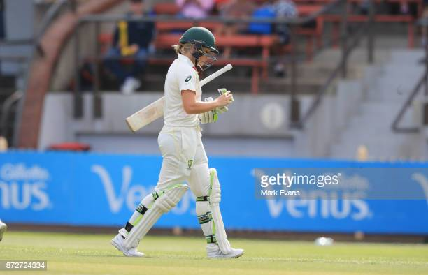 Alyssa Healy of Australia walks off after being caught for 45 during day three of the Women's Test match between Australia and England at North...