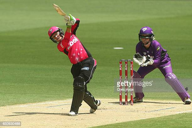 Alyssa Healy of the Sixers bats during the Women's Big Bash League semi final match between the Sydney Sixers and the Hobart Hurricanes at The Gabba...