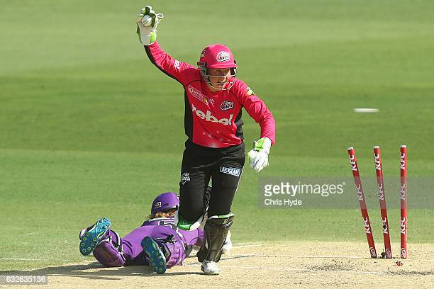 Alyssa Healy of the Sixers celebrates running out Heather Knight of the Hurricanes bats during the Women's Big Bash League semi final match between...