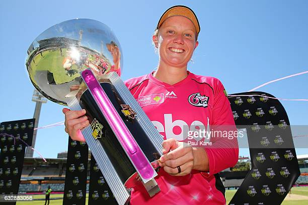 Alyssa Healy of the Sixers holds the trophy after winning the Women's Big Bash League match between the Perth Scorchers and the Sydney Sixers at WACA...