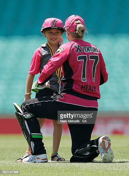 Alyssa Healy of the Sixers signs a cap for a young girl the Women's Big Bash League match between the Sydney Sixers and the Perth Scorchers at Sydney...