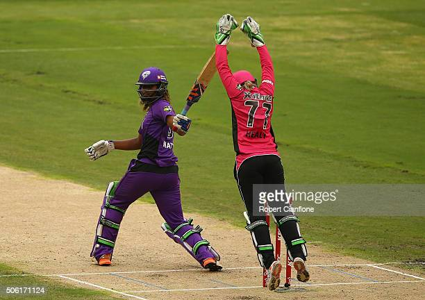 Alyssa Healy of the Sixers takes a catch to dismiss Hayley Matthews of the Hurricanes during the Women's Big Bash League Semi Final match between the...