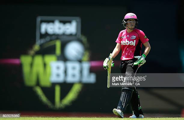 Alyssa Healy of the Sixers walks from the field after being dismissed during the Women's Big Bash League match between the Sydney Sixers and the...