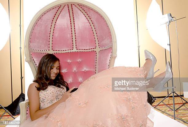 Alyssa Linares winner of Verizon's My Fabulous Quince essay contest enjoys her new BlackBerry Z10 during her style session with Jennifer Lopez on...