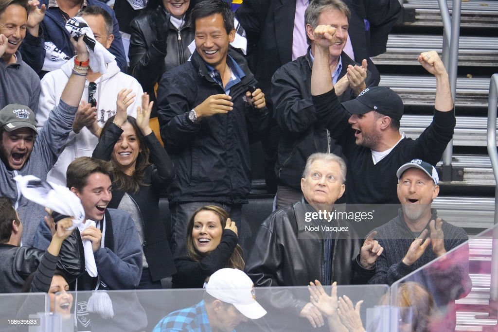 Alyssa Milano (C) and husband David Bugliari attend an NHL playoff game between the St. Louis Blues and the Los Angeles Kings at Staples Center on May 10, 2013 in Los Angeles, California.