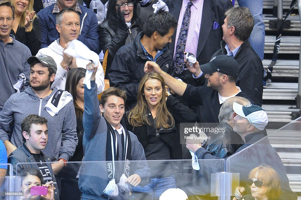 <a gi-track='captionPersonalityLinkClicked' href=/galleries/search?phrase=Alyssa+Milano&family=editorial&specificpeople=203329 ng-click='$event.stopPropagation()'>Alyssa Milano</a> (C) and husband David Bugliari attend an NHL playoff game between the St. Louis Blues and the Los Angeles Kings at Staples Center on May 10, 2013 in Los Angeles, California.