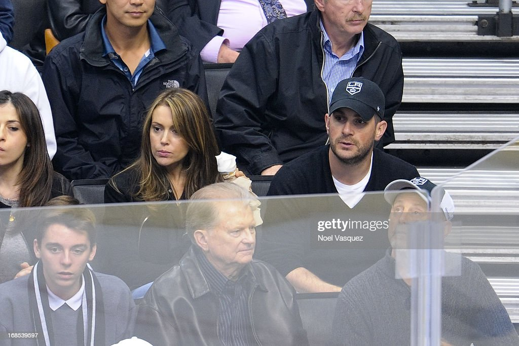 <a gi-track='captionPersonalityLinkClicked' href=/galleries/search?phrase=Alyssa+Milano&family=editorial&specificpeople=203329 ng-click='$event.stopPropagation()'>Alyssa Milano</a> and husband David Bugliari attend an NHL playoff game between the St. Louis Blues and the Los Angeles Kings at Staples Center on May 10, 2013 in Los Angeles, California.