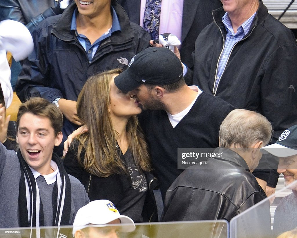 Alyssa Milano and husband David Bugliari kiss at the conclusion of an NHL playoff game between the St. Louis Blues and the Los Angeles Kings at Staples Center on May 10, 2013 in Los Angeles, California.