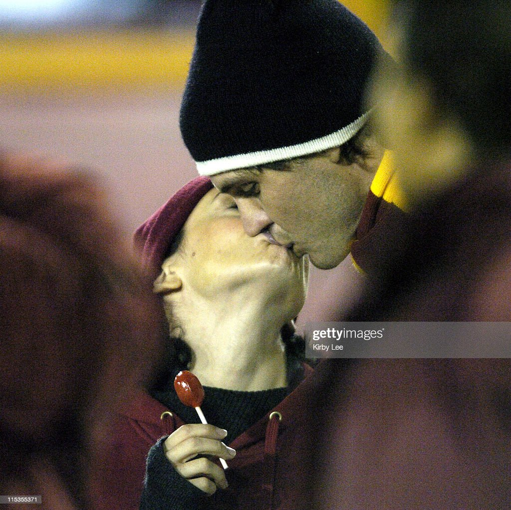 Alyssa Milano and Oakland Athletics pitcher and USC alumnus Barry Zito kiss at USC football game against Arizona at the Los Angeles Memorial Coliseum...