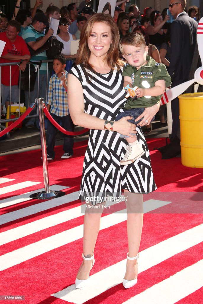 <a gi-track='captionPersonalityLinkClicked' href=/galleries/search?phrase=Alyssa+Milano&family=editorial&specificpeople=203329 ng-click='$event.stopPropagation()'>Alyssa Milano</a> (L) and son, Milo Bugliari arrive at the Los Angeles premiere of 'Planes' held at the El Capitan Theatre on August 5, 2013 in Hollywood, California.