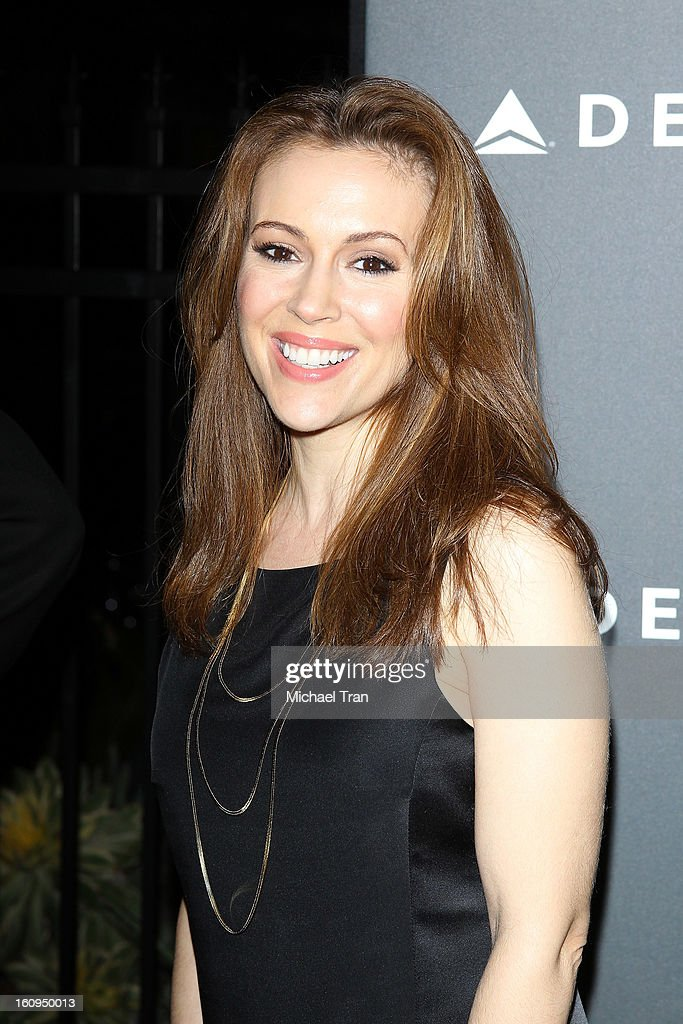 Alyssa Milano arrives at Delta Air Lines celebrates the GRAMMY Awards held at The Getty House on February 7, 2013 in Los Angeles, California.