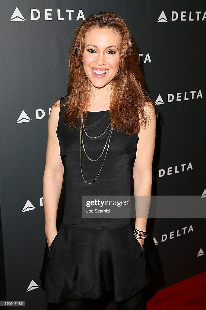 Alyssa Milano arrives at Delta Air Lines' GRAMMY Celebration At Getty House on February 7, 2013 in Los Angeles, California.