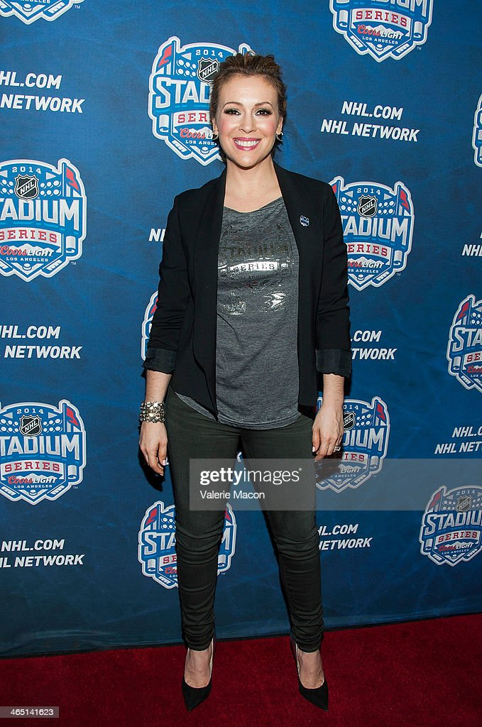 <a gi-track='captionPersonalityLinkClicked' href=/galleries/search?phrase=Alyssa+Milano&family=editorial&specificpeople=203329 ng-click='$event.stopPropagation()'>Alyssa Milano</a> arrives at the 2014 Coors Light NHL Stadium Series Los Angeles at Dodger Stadium on January 25, 2014 in Los Angeles, California.