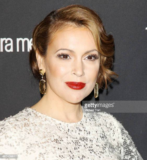 Alyssa Milano arrives at The Weinstein Company and NetFlix 2014 Golden Globe Awards after party held on January 12 2014 in Beverly Hills California