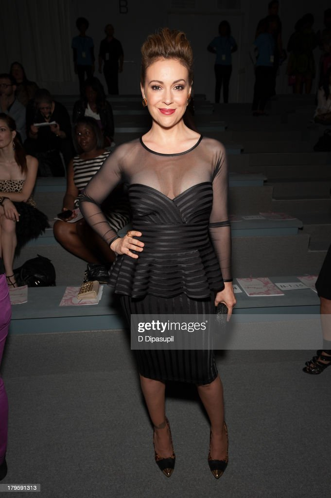 Alyssa Milano attends the Tadashi Shoji Spring 2014 fashion show at The Stage Lincoln Center on September 5, 2013 in New York City.