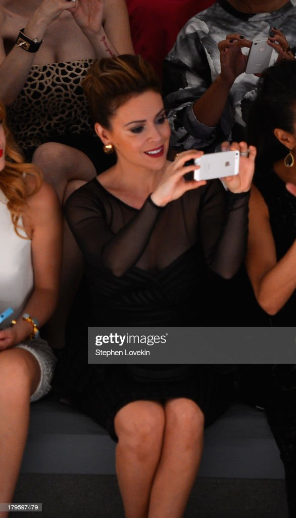 Alyssa Milano attends the Tadashi Shoji Spring 2014 fashion show during Mercedes-Benz Fashion Week at The Stage at Lincoln Center on September 5, 2013 in New York City.