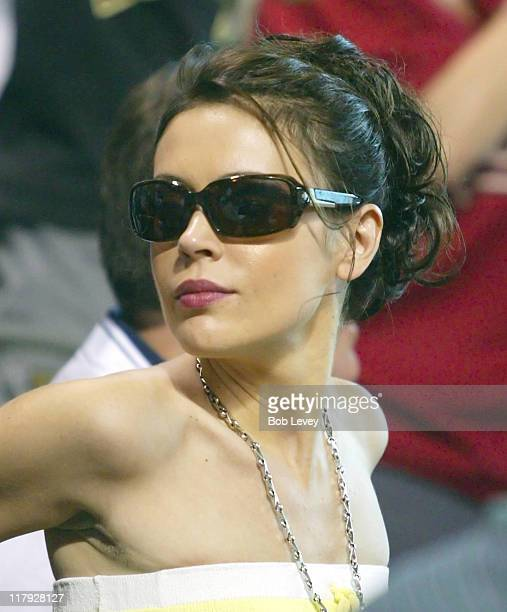 Alyssa Milano girlfriend of Dodgers pitcher Brad Pennytakes in the Dodgers vs Astros at Minute Maid Park July 10 2005 in HoustonTexas