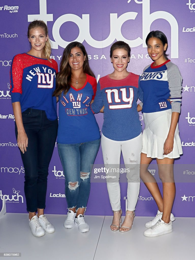 Alyssa Milano (2nd from right) poses with models at Macy's Herald Square on August 23, 2017 in New York City.