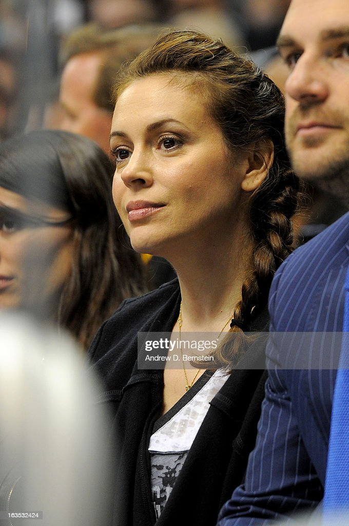 Alyssa Milano watches the game between the Los Angeles Kings and the Calgary Flames at Staples Center on March 11, 2013 in Los Angeles, California.