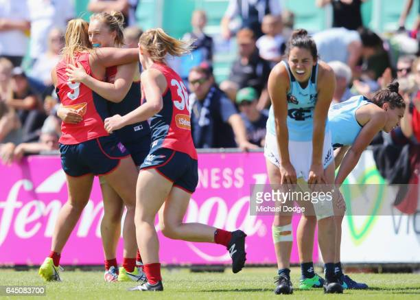 Alyssa Misfud of the Demons celebrates a goal during the round four Women's AFL match between the Melbourne Demons and the Carlton Blues at Casey...
