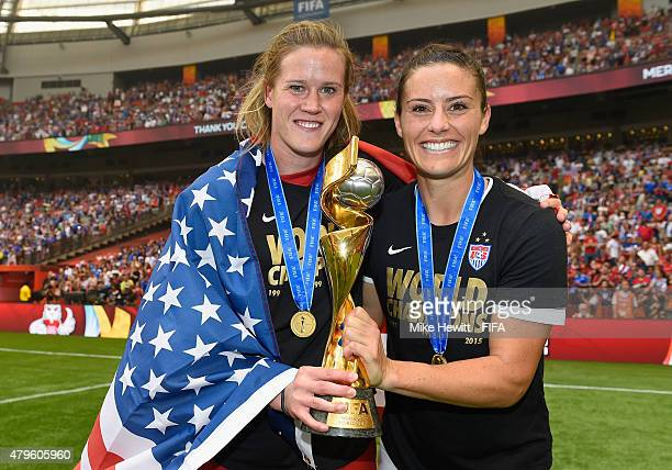Alyssa Naeher and Alex Krieger of USA hold the Winner's Trophy at the end of the FIFA Women's World Cup 2015 Final between USA and Japan at BC Place...
