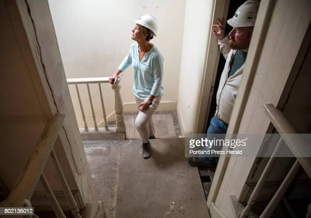 Alyssa Parker Director of Commercial Project Management at WrightRyan Construction looks over a stairwell with superintendent Olin Williams at a...