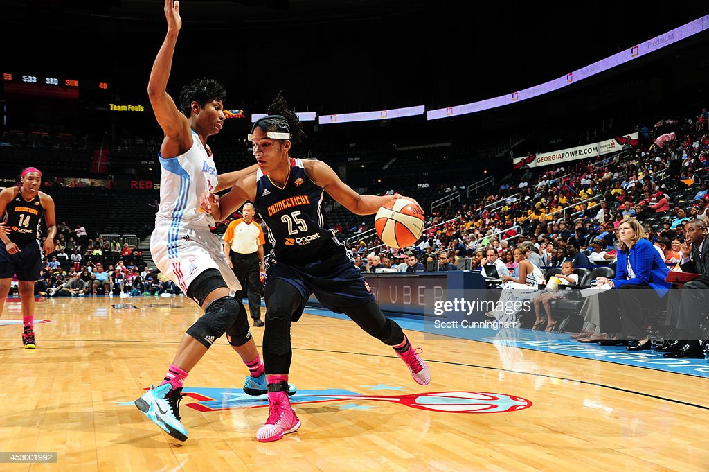 Alyssa Thomas #25 of the Connecticut Sun drives to the basket against Angel McCoughtry #35 of the Atlanta Dream on July 29, 2014 at Philips Arena in Atlanta, Georgia.