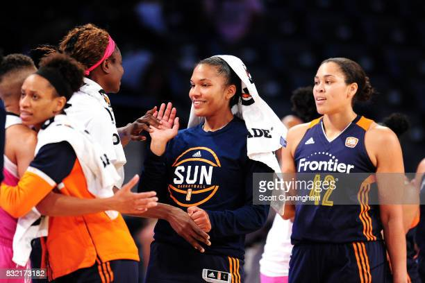 Alyssa Thomas of the Connecticut Sun high fives her teammates during the game against the Atlanta Dream during at WNBA game on August 15 2017 at Hank...
