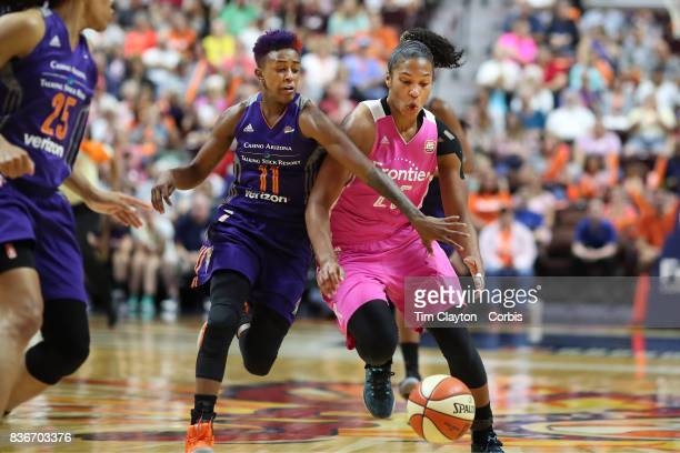 Alyssa Thomas of the Connecticut Sun is fouled by Danielle Robinson of the Phoenix Mercury during the Connecticut Sun Vs Phoenix Mercury WNBA regular...