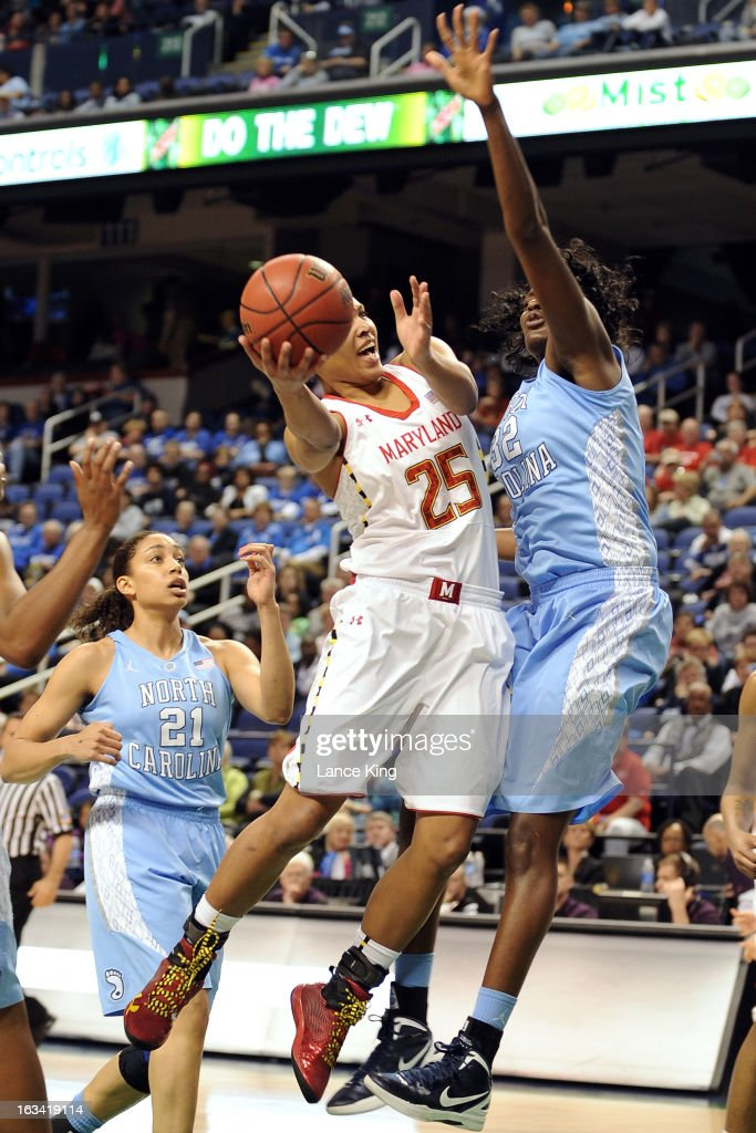 Alyssa Thomas #25 of the Maryland Terrapins goes to the hoop against Waltiea Rolle #32 of the North Carolina Tar Heels during the semifinals of the 2013 Women's ACC Tournament at the Greensboro Coliseum on March 9, 2013 in Greensboro, North Carolina.