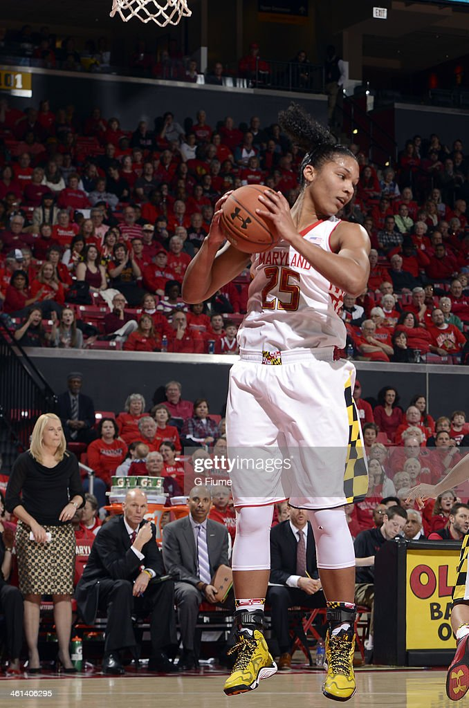 Alyssa Thomas #25 of the Maryland Terrapins grabs a rebound against the Connecticut Huskies at the Comcast Center on November 15, 2013 in College Park, Maryland.