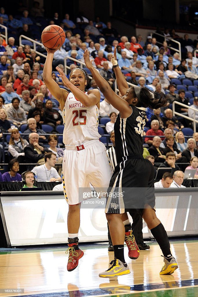 Alyssa Thomas #25 of the Maryland Terrapins puts up a shot against Asia Williams #33 of the Wake Forest Demon Deacons during the quarterfinals of the 2013 Women's ACC Tournament at the Greensboro Coliseum on March 8, 2013 in Greensboro, North Carolina.