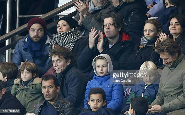 Alysson Paradis and her boyfriend Benjamin Biolay and his girlfriend Vanessa Paradis below them Raphael Haroche attend the French Ligue 1 match...
