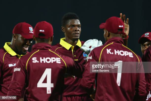 Alzarri Joseph of West Indies celebrates taking the wicket of Eoin Morgan of England caught by Kyle Hope during the 4th Royal London One Day...