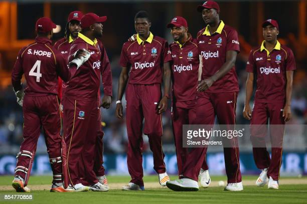 Alzarri Joseph of West Indies celebrates taking the wicket of Joe Root of England caught by Shai Hope with his team mates during the 4th Royal London...