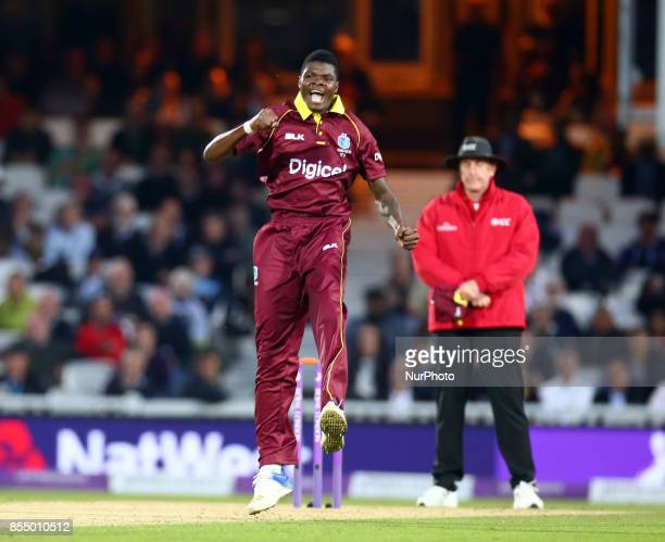 Alzarri Joseph of West Indies celebrates the catch of England's Joe Root by Shai Hope of West Indies during 4th Royal London One Day International...