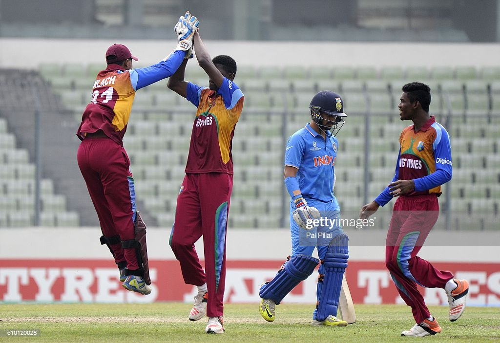 Alzarri Joseph of West Indies U19 celebrates the wicket of Anmolpreet Singh of India with teammate Tevin Imlach of West Indies U19 during the ICC U19 World Cup Final Match between India and West Indies on February 14, 2016 in Dhaka, Bangladesh.