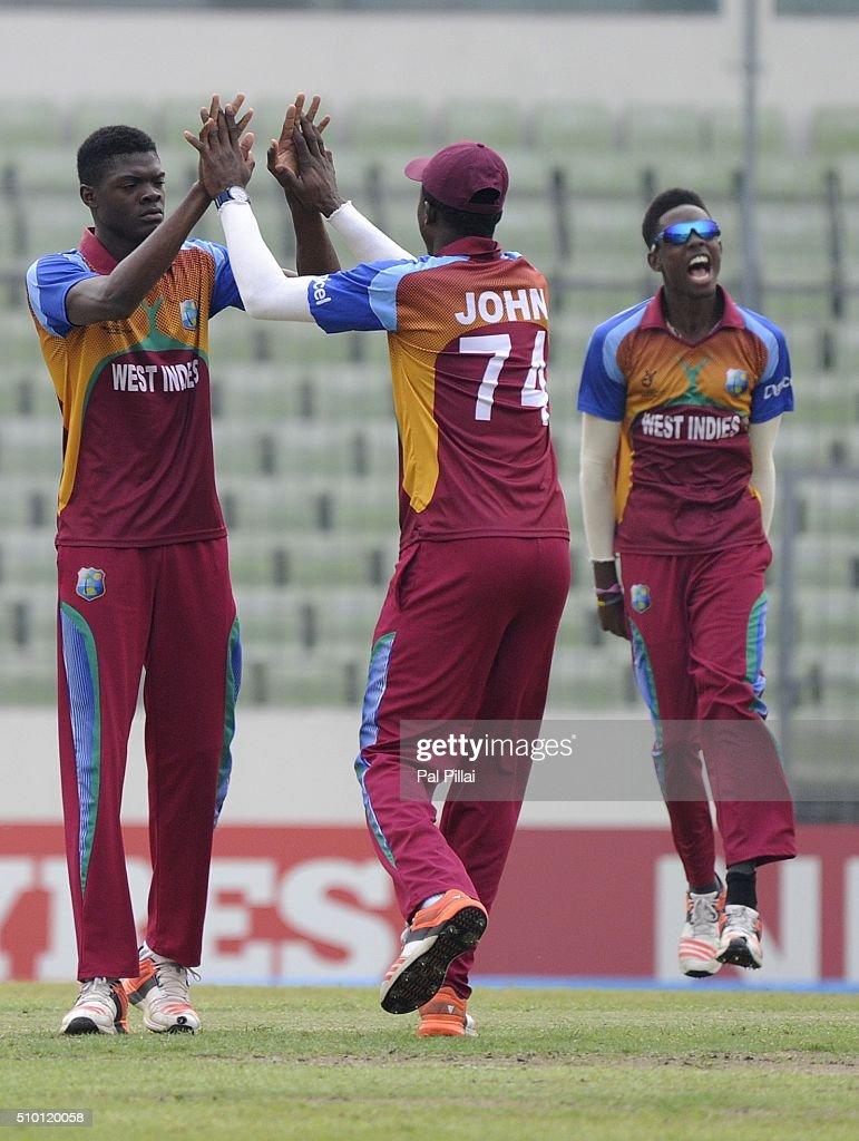 Alzarri Joseph of West Indies U19 celebrates the wicket of Ishan Kishan of India during the ICC U19 World Cup Final Match between India and West Indies on February 14, 2016 in Dhaka, Bangladesh.
