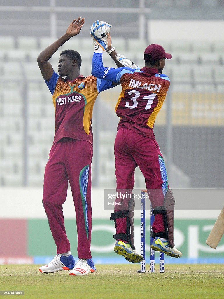 Alzarri Joseph of West Indies U19 celebrates the wicket of Mohammed Saif Hassan of Bangladesh U19 during the ICC U 19 World Cup Semi-Final match between Bangladesh and West Indies on February 11, 2016 in Dhaka, Bangladesh.