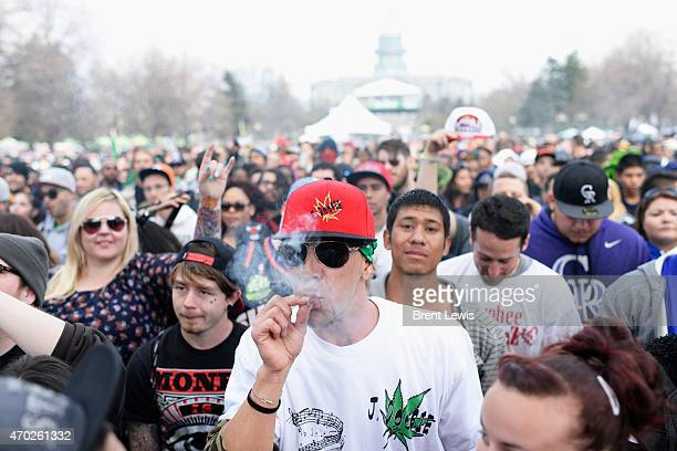 Am attendee smokes marijuana during the Devin the Dude performance on Saturday April 18 2015 at Civic Center Park in Denver Colorado The annual 420...