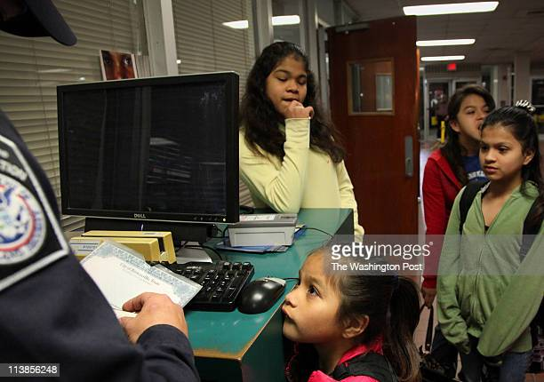 545 am Umeko Perdomo bottom has her birth certificate checked at the Gateway International Bridge as she crosses the USMexico border on her way to...