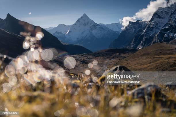 Ama Dablam mountain peak with light Bokeh, Dzongla village, Everest region, Nepal