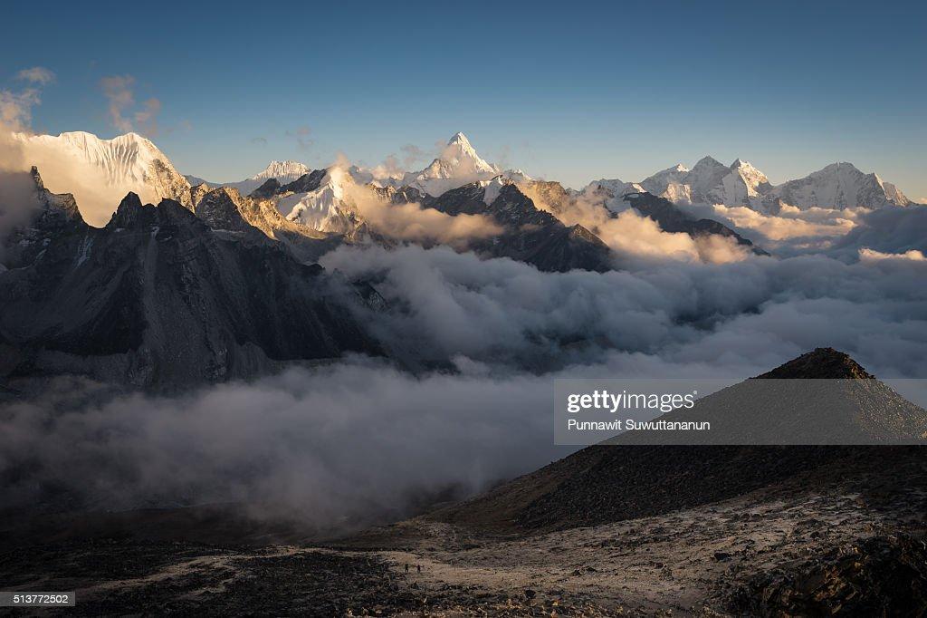 Ama Dablam mountain peak with sea of mist, Everest region